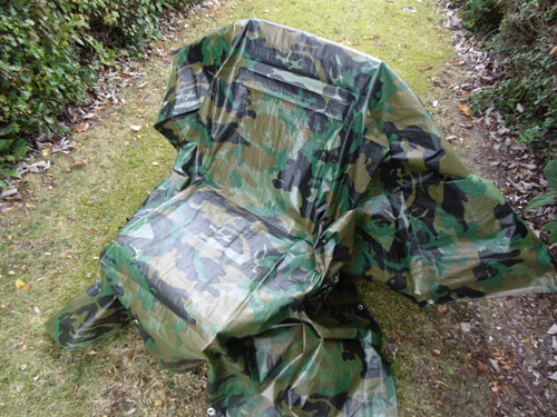 Camo Tarp Covering Garden Chair